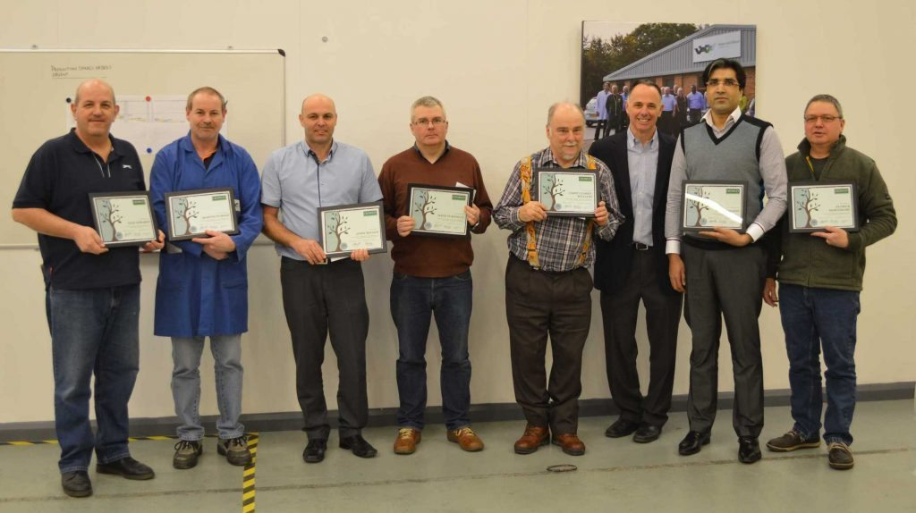 Pictured L to R: Nick Edwards (40 years); Martin Purser (20 years); John Wilson (25 years); Dave Turnbull (15 years); Chris Clarke-Williams (35 years); Shoaib Idrees (5 years); and Patrick Mortimore (10 years). Andrew Marcou, Crowley Company CFO (third from right), presented plaques and gifts during a recent visit.